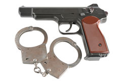 Pistol with handcuffs isolated. On white background Royalty Free Stock Photo