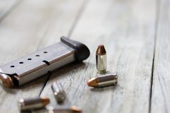Pistol Handgun Magazine Clip and Bullets Royalty Free Stock Photo