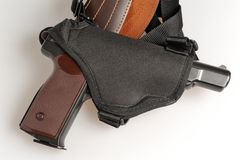 Pistol in holster  on gray. Background Royalty Free Stock Images