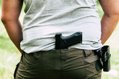 Pistol in the holster. The shooter trains. Is preparing to shoot at the target Stock Images