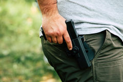 Pistol in the holster. The shooter trains. Is preparing to shoot at the target.  Stock Images