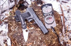 Pistol, knife and compass. Military set. The weapon. royalty free stock images