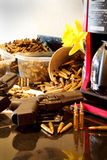 Pistol in Home Environment. A pistol laying on a kitchen counter by a coffee pot in a home environment.  Empty brass casings in the background, bullets in Royalty Free Stock Photos