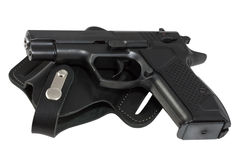The pistol lays on holster. The automatic pistol lays on holster black color Royalty Free Stock Photos