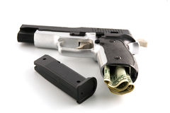 The pistol loaded by dollars Royalty Free Stock Images