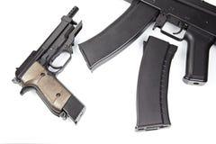 Pistol and machine gun Stock Photos