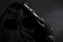 Pistol and mask of a thief background 2 Royalty Free Stock Image