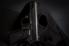 Pistol and mask of a thief background 3 Royalty Free Stock Photography