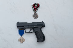 Pistol with medal. On a table in germany Stock Image