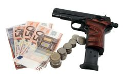 Pistol and money. Pistol with one round and money isolated on white Stock Image