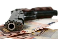 Pistol and money. On white Royalty Free Stock Images