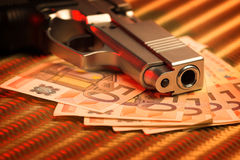 Pistol and money Stock Photos
