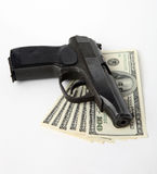 Pistol and money Royalty Free Stock Photo