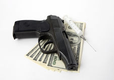 Pistol, money and syringe Stock Images