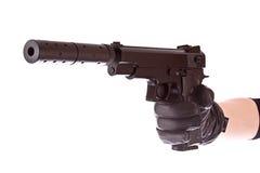 Pistol på den isolerade svarta handsken Royaltyfri Foto