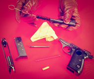 Pistol. Pieces of Non Assembled Pistol on Red Background, Instagram Effect Stock Image