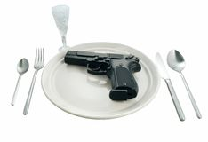 Pistol in a plate on the served table Stock Photo
