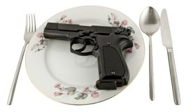 Pistol in a plate on the served table. Isolated on white background Stock Photo