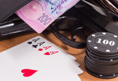 Pistol and playing cards Stock Photography