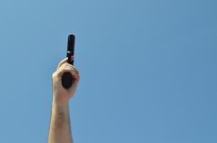 Pistol Pointed at Sky Stock Images