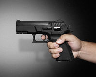 Pistol pointing Royalty Free Stock Photos