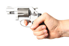 Pistol pointing. A hand holding a firearm, isolated Royalty Free Stock Photography