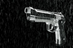 Pistol in the rain. Royalty Free Stock Photography