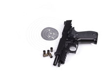 Pistol on the raked target Royalty Free Stock Images