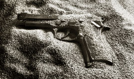 Pistol in sand. Close up photo of a Pistol in sand Stock Photo