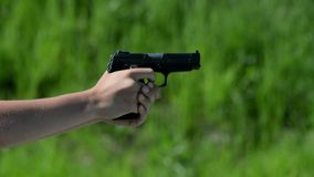 Pistol shooting on green background stock video footage