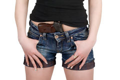 Pistol in shorts. Young woman with pistol. Isolated on white Royalty Free Stock Image