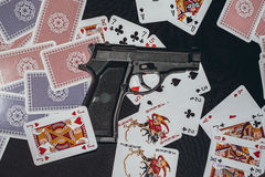 Pistol on the table with a cards Royalty Free Stock Photo