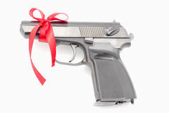 Pistol tied with a ribbon. Stock Images