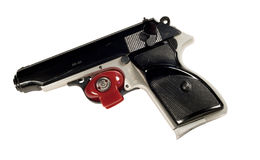 Pistol and trigger lock. Red trigger lock on a pistol with clipping path at this size Royalty Free Stock Photo