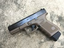 Pistol two tone. On the floor Royalty Free Stock Photography