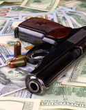 Pistol and US dollars Stock Images