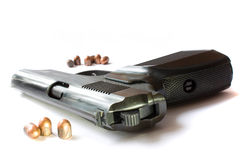 Pistol on a white background with bullets Stock Image