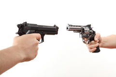 Pistola bianca della tenuta di due mani Fotografie Stock