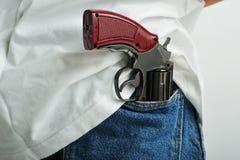 Pistola in casella Fotografia Stock Libera da Diritti