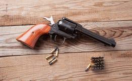 Pistola con le pallottole Immagini Stock