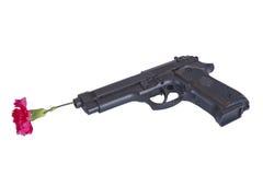 Pistola con un fiore Fotografia Stock