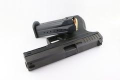 Pistola con una revista Fotos de archivo
