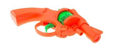 Pistola del cappuccio del giocattolo su un fondo bianco Immagini Stock Libere da Diritti