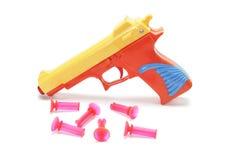 Pistola del giocattolo con le pallottole di gomma Fotografia Stock Libera da Diritti