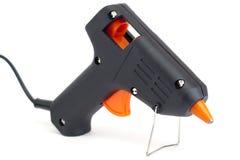 Pistola del pegamento aislada en blanco. Foto de archivo libre de regalías
