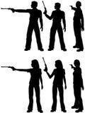 Pistola dell'obiettivo del tiro della donna dell'uomo della siluetta Fotografia Stock Libera da Diritti