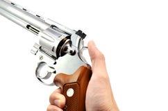 Pistola della holding della mano Fotografie Stock