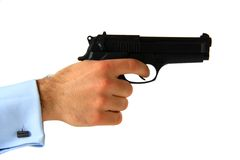 Pistola della tenuta dell'uomo di affari Fotografia Stock