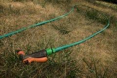 Pistola di acqua e tubo flessibile dell'acqua Fotografia Stock