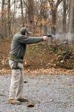 Pistola di infornamento dell'uomo Fotografie Stock